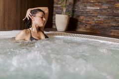 Young woman in hot tub Stock Photo