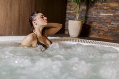 Young woman in hot tub Stock Photography