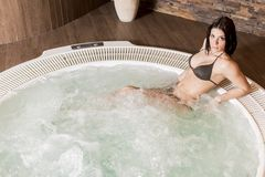 Young woman in hot tub Royalty Free Stock Photo