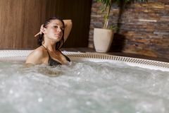 Young woman in hot tub Royalty Free Stock Image