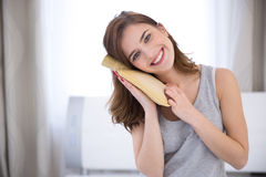 Young woman with a hot water bottle Royalty Free Stock Photos