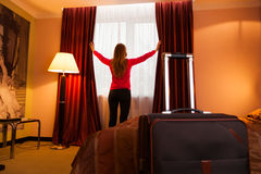 Young woman in a hotel opening Stock Photography