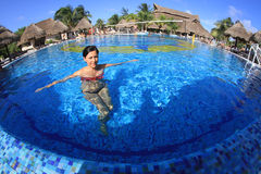 Young woman at hotel pool Royalty Free Stock Images