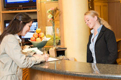 Young woman at the hotel reception Stock Photography