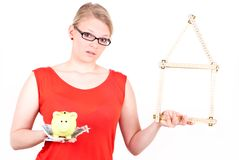 Young woman with house symbol and piggy bank Stock Photography