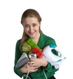 Young woman with household appliances and present Royalty Free Stock Images