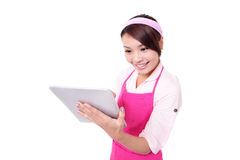 Young woman housewife with tablet pc Stock Image