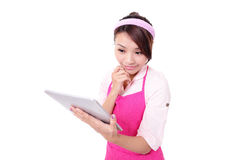 Young woman housewife with tablet pc Stock Images