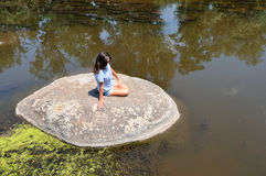 Young woman on a huge stone Stock Image