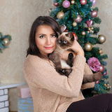 Young woman hugging cat Royalty Free Stock Image