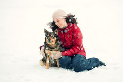 Young woman hugging dog Royalty Free Stock Image
