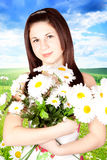 Young Woman Hugging Flowers Royalty Free Stock Photo