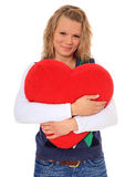 Young woman hugging heart-shaped pillow Royalty Free Stock Photography