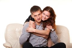 Young woman hugging her boyfriend Stock Photo