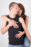 Young woman hugging her boyfriend Stock Photos