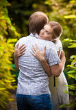 Young woman hugging her boyfriend Royalty Free Stock Images