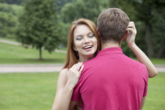 Young woman hugging her boyfriend Stock Photography