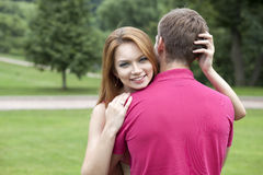 Young woman hugging her boyfriend Royalty Free Stock Image