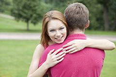 Young woman hugging her boyfriend Royalty Free Stock Photo