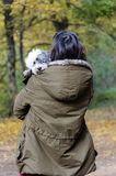 Young woman hugging her poodle dog. Happy girl  hugging dog outdoor Royalty Free Stock Image