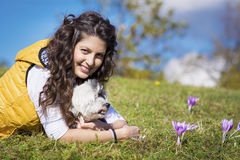 Young woman hugging her white  dog outdoor Royalty Free Stock Photography