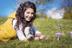 Young woman hugging her white  dog outdoor Stock Photos