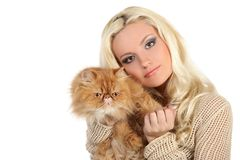 Young woman hugging a large soft red cat Stock Photo