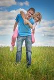 Young woman hugging man Stock Photo