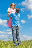 Young woman hugging man Stock Images