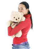 Young woman hugging Teddy bear Royalty Free Stock Photography