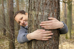 Young woman hugging a tree Royalty Free Stock Photos
