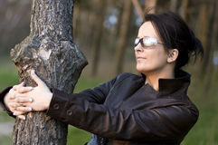 Young woman hugging tree Royalty Free Stock Photos