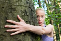 Young woman hugging a tree. stock photo