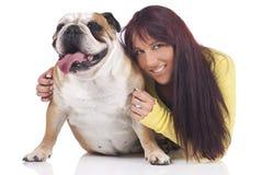 Young woman hugs english bulldog Royalty Free Stock Images