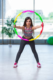 The young woman with hula loop in gym in health concept Royalty Free Stock Image