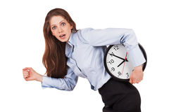 Woman in a hurry with the clock under his arm Royalty Free Stock Photos