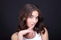 Young woman hush Stock Image