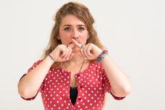 Young woman hushing Stock Photography