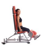 Young woman on hydraulic exerciser Stock Photo