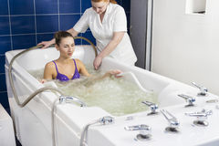 Young woman during hydromassage. Young women during hydromassage in beauty salon Royalty Free Stock Photography