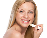 Young woman with hygienic lipstick Stock Photo