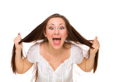 Young woman in hysterics. Isolated on white Royalty Free Stock Photography