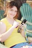 Young woman on i pod. Woman smiling on i pod Stock Photo
