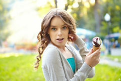 Young woman with ice cream. Stock Images
