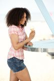 Young woman with ice cream at the beach Stock Photo