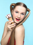 Young woman with ice cream Stock Images