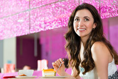 Young woman in ice cream parlor Stock Image