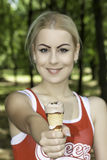 Young woman with ice cream. Portrait of young woman with ice cream royalty free stock photos