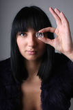 Young woman with ice cube instead of her eye Royalty Free Stock Photography