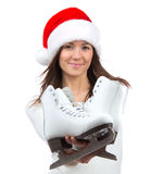 Young woman with ice skates smiling. Isolated on a white background. Christmas new year holiday gift concept Stock Photo